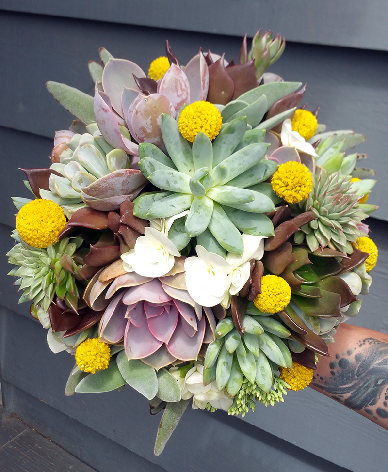 Wedding bouquet with succulents and white and yellow flowers