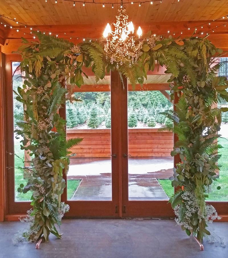 Ferns and greens ceremony arch