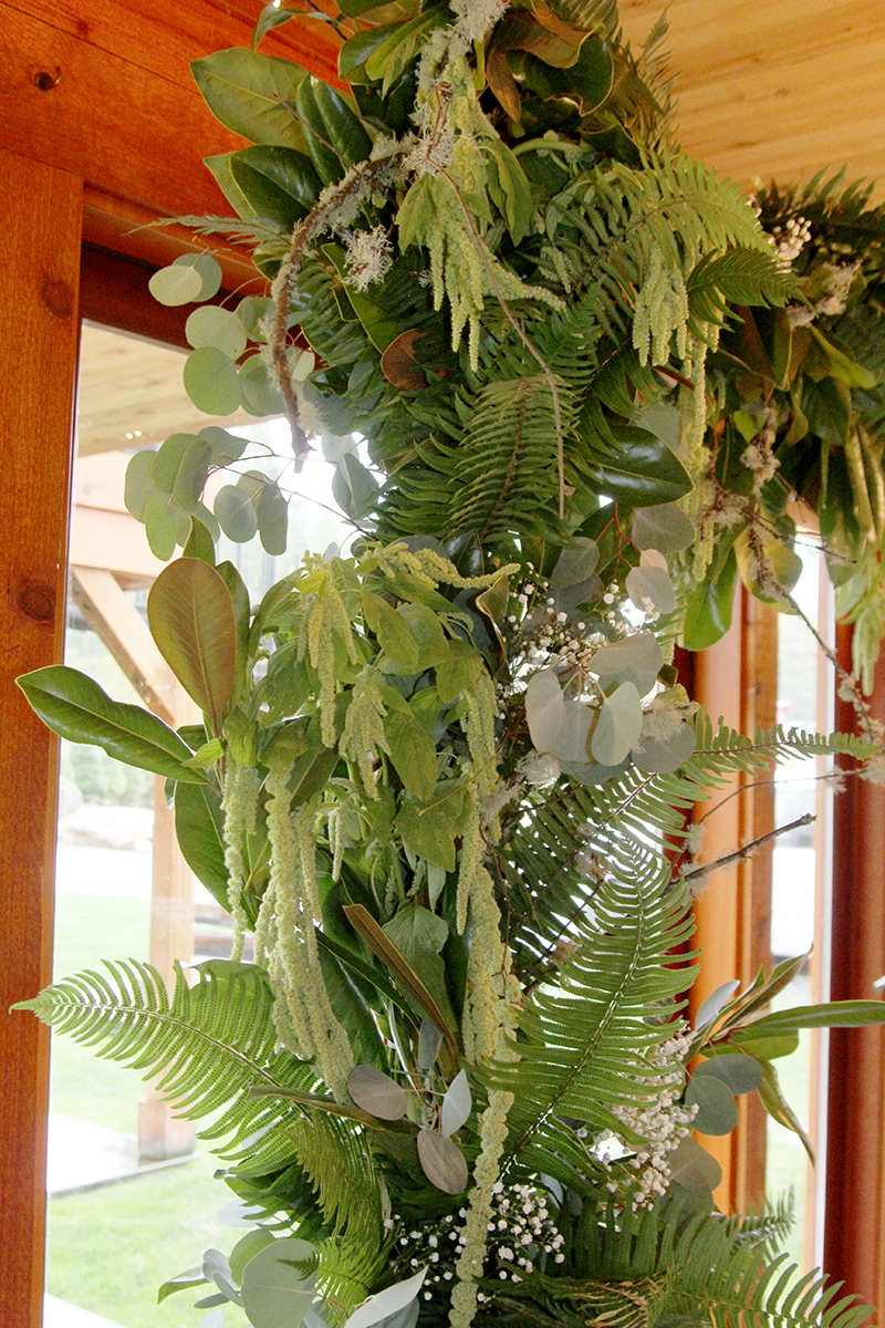 Ferns and greens ceremony arch detail