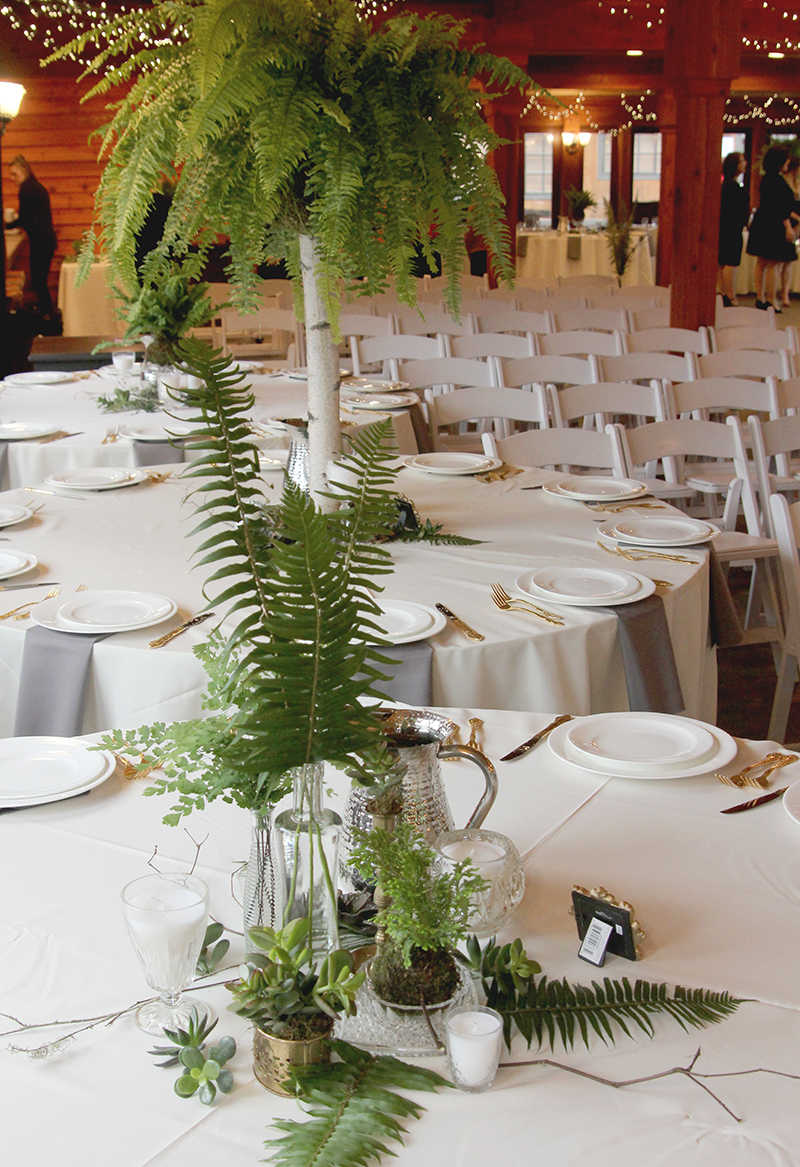 Ferns and greens wedding table centerpiece