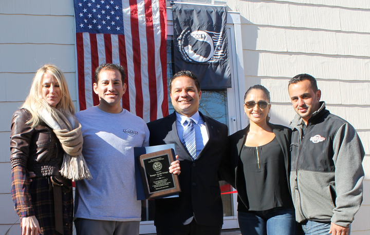 LEFT TO RIGHT: Welcome Home recipients Leah Ottenbreit and Jacob Wolf, Atlantic Beach Mayor George Pappas, Above All Masonry owners Lisbeth Bono and Stephen Bono