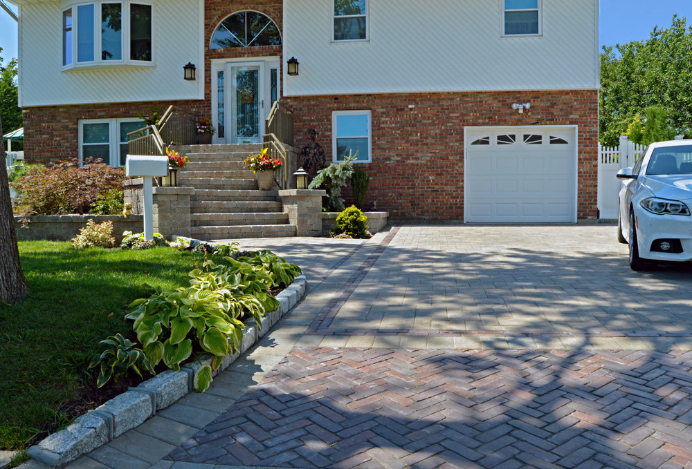 2 car driveway and steps to front entrance with concrete pavers in Long Island, NY