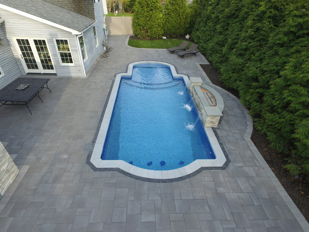 elegant swimming pool waterfall feature in Long Island, NY
