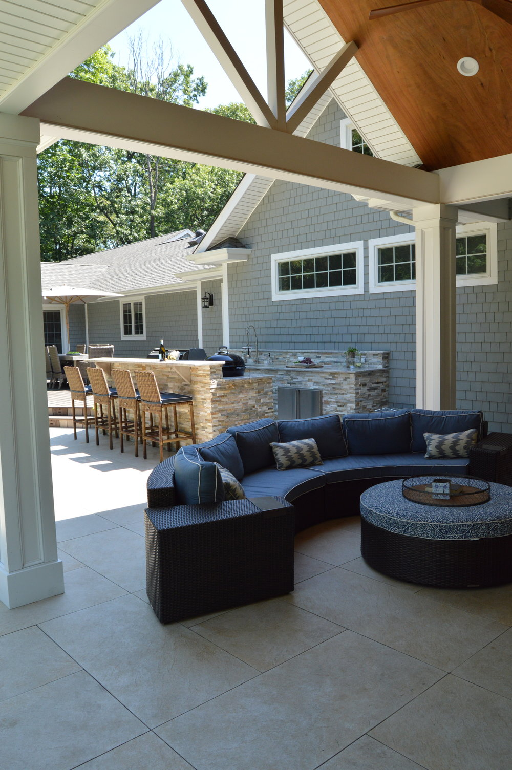 couch on a patio near outdoor kitchen in Smithtown, NY