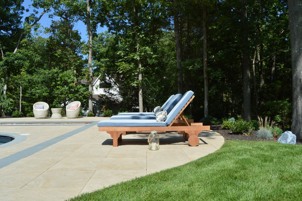 Natural stone patio by the swimming pool in Smithtown, NY