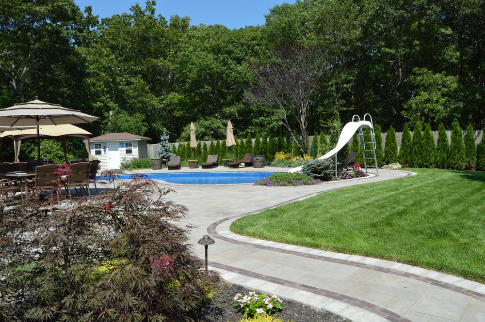 Holbrook, NY swimming pool patio, walkway, and landscape design
