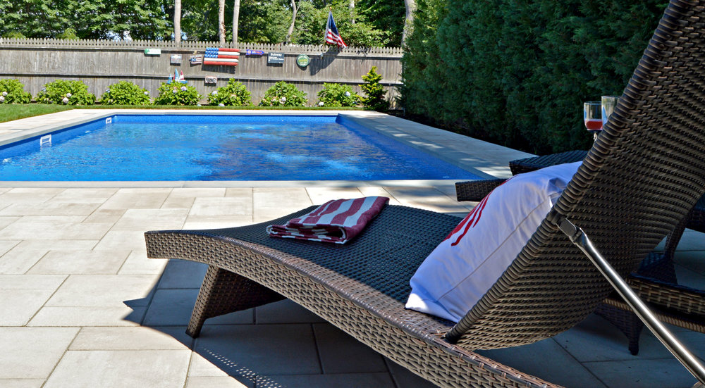 Babylon, NY swimming pool patio and lounge chair