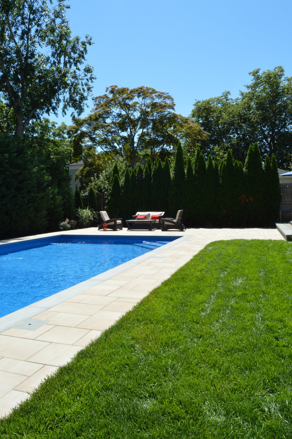 Babylon, NY modern swimming pool patio and landscape design