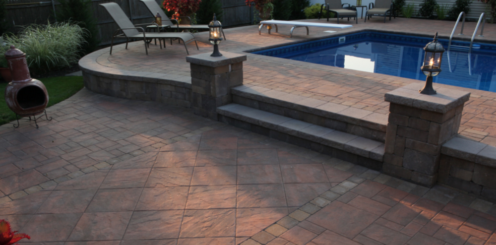 swimming pool patio with Cambridge paving stones in Nesconset, NY