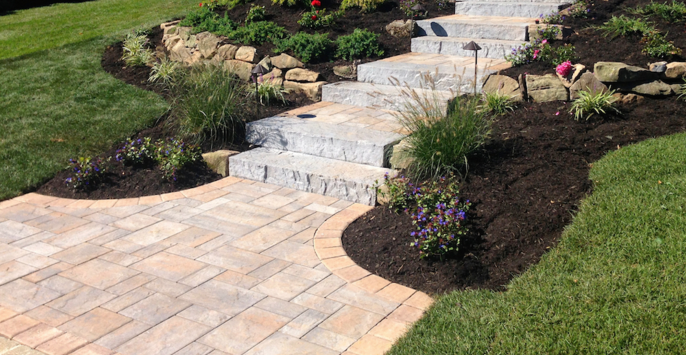 concrete paver walkway and steps front entrance and plantings in Dix Hills, NY