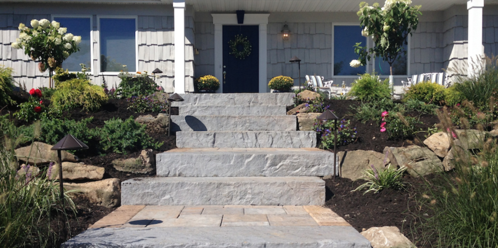 concrete paver walkway and steps front entrance in Dix Hills, NY