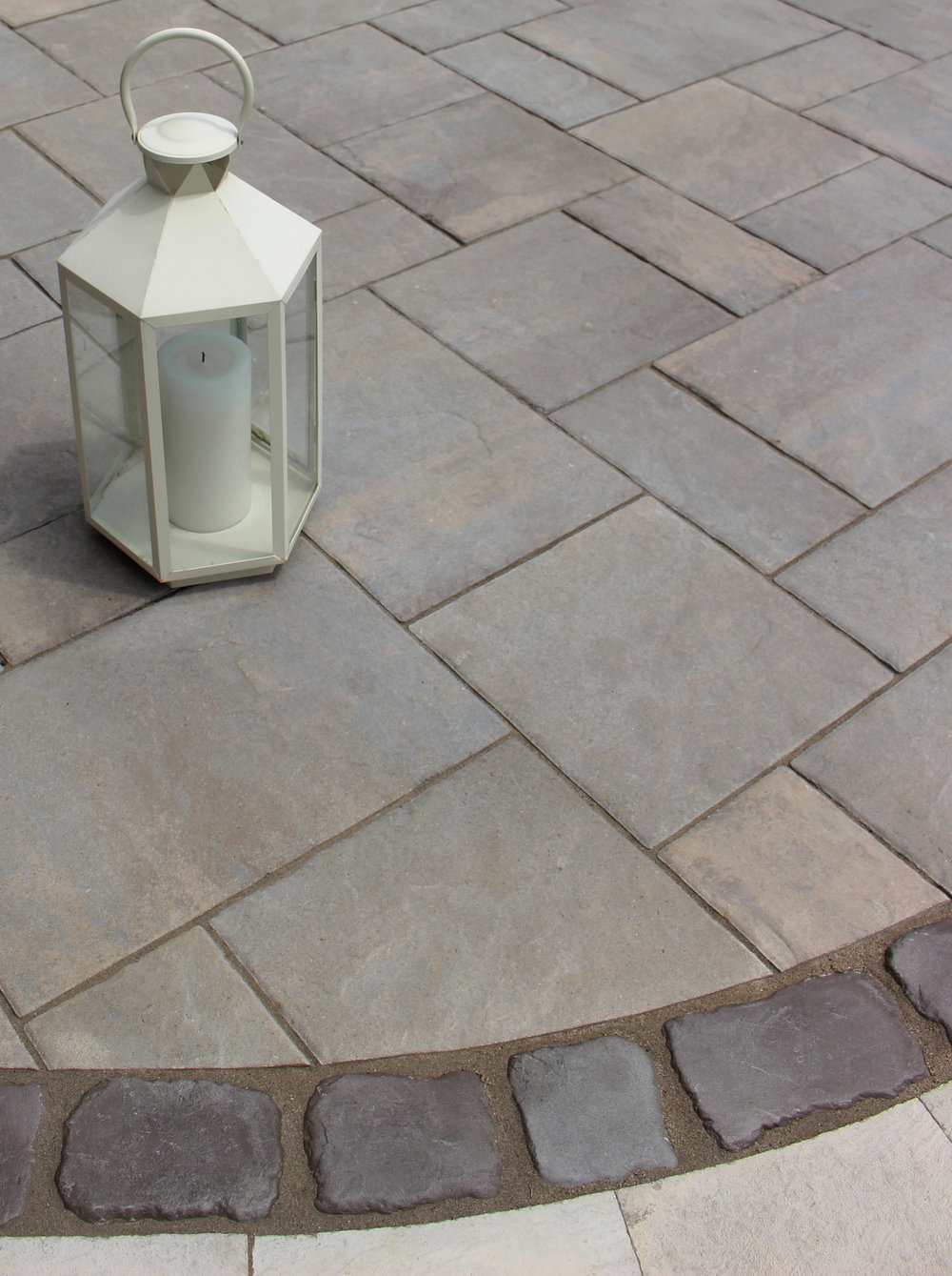 Unilock pavers with border on a patio in Massapequa, NY