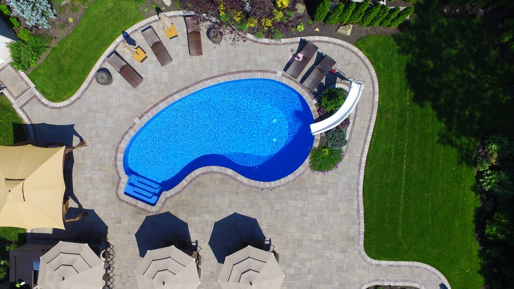 Holbrook, NY swimming pool patio, walkway, and landscape design whole project view