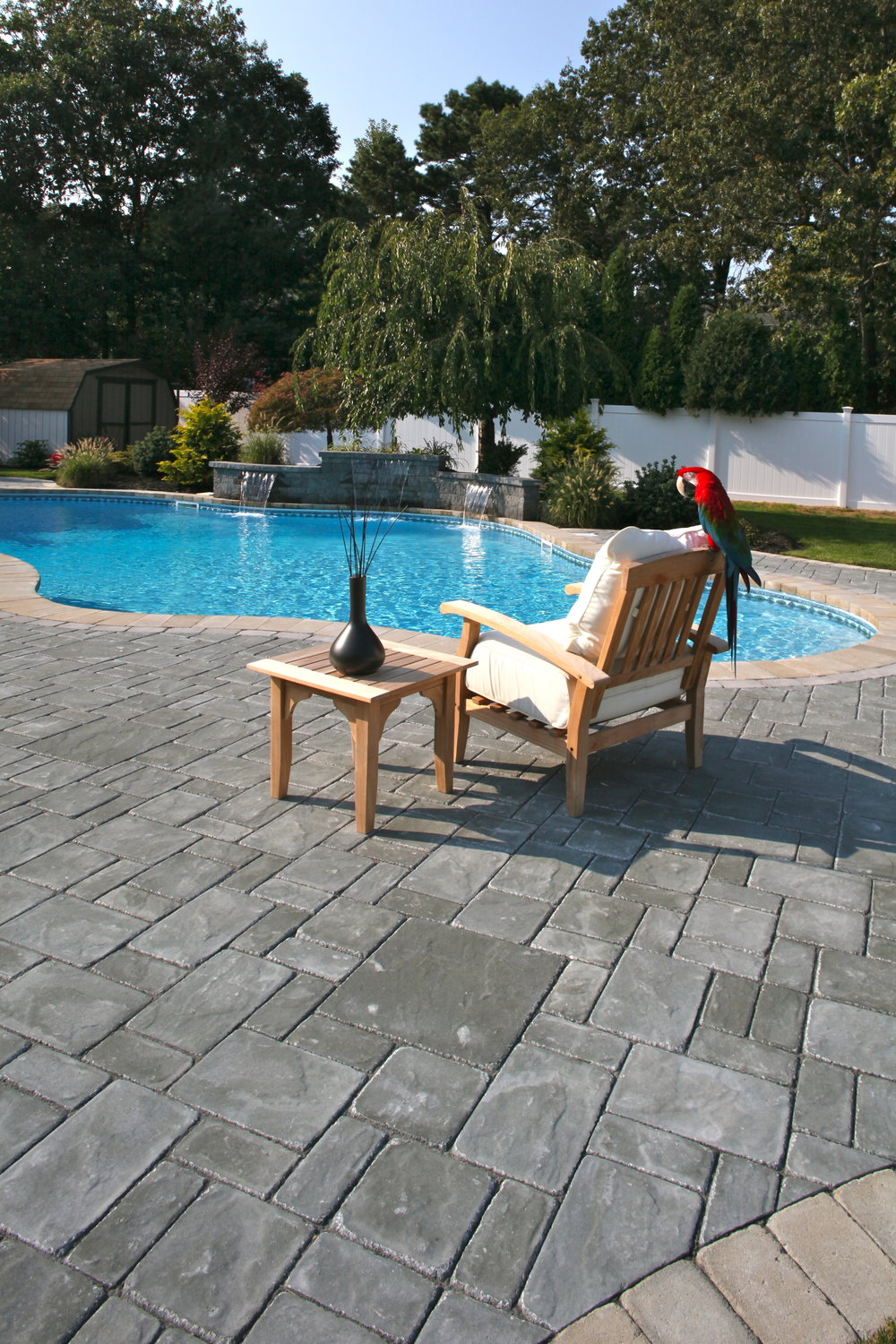 ... NY Relaxing By A Freeform Swimming Pool Design And Walk Up Patio In  Long Island, ...