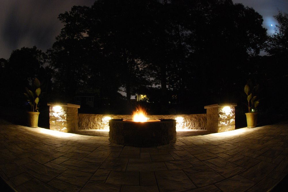 Smithtown, NY outdoor lighting at a paver custom fire pit