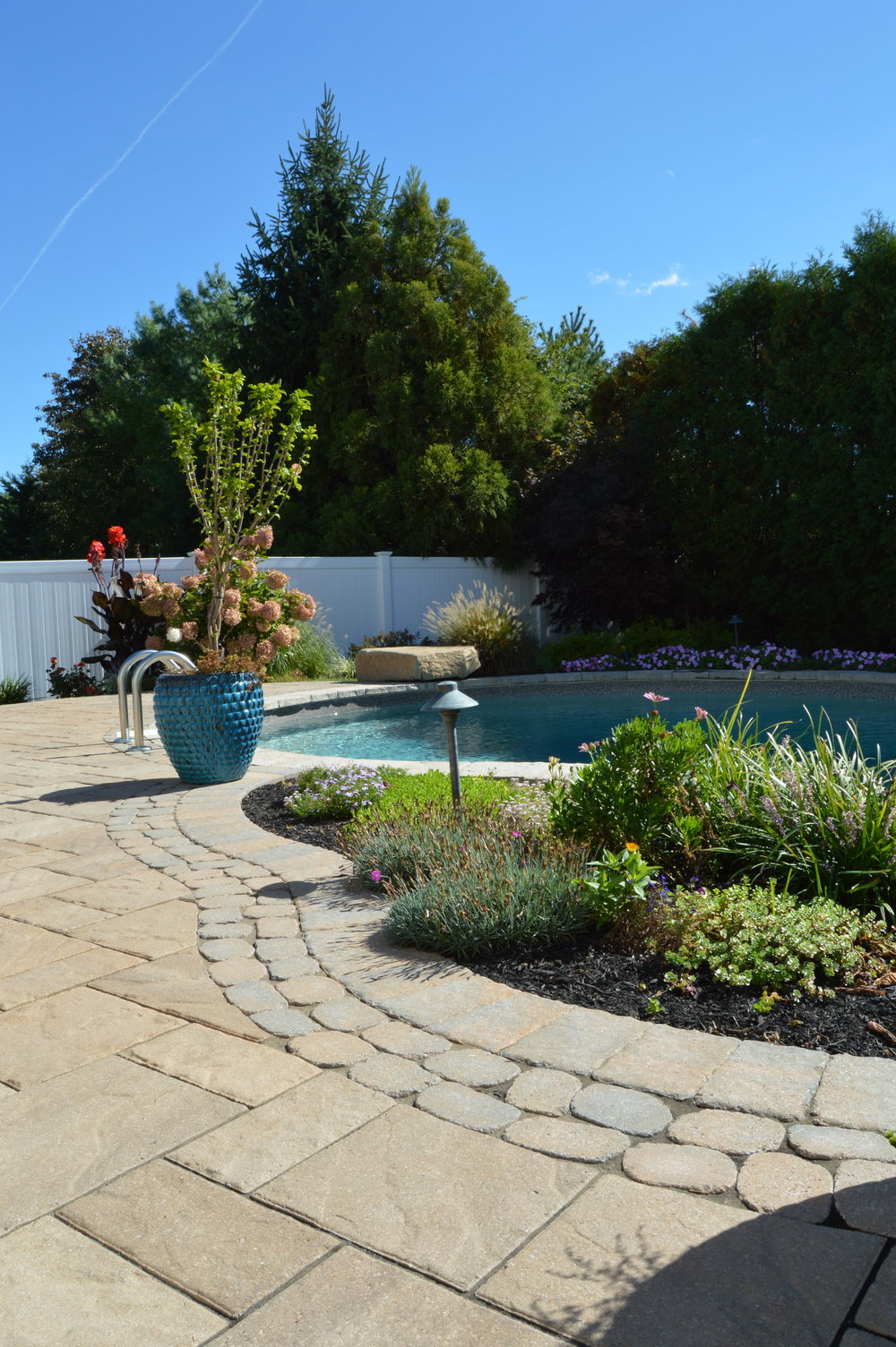 Smithtown, NY swimming pool and fire pit