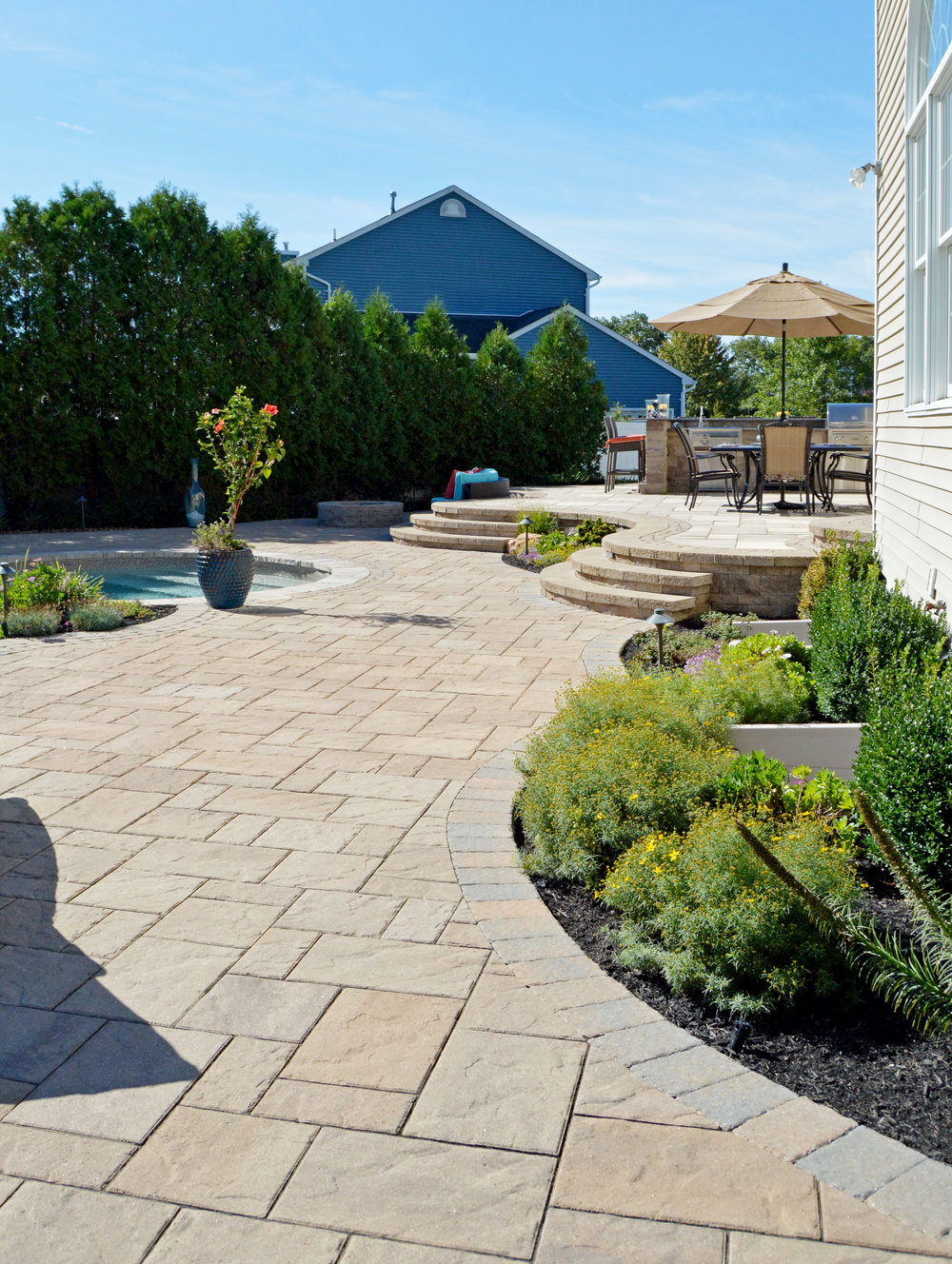 Outdoor kitchen and backyard landscape design in Huntington Station, NY