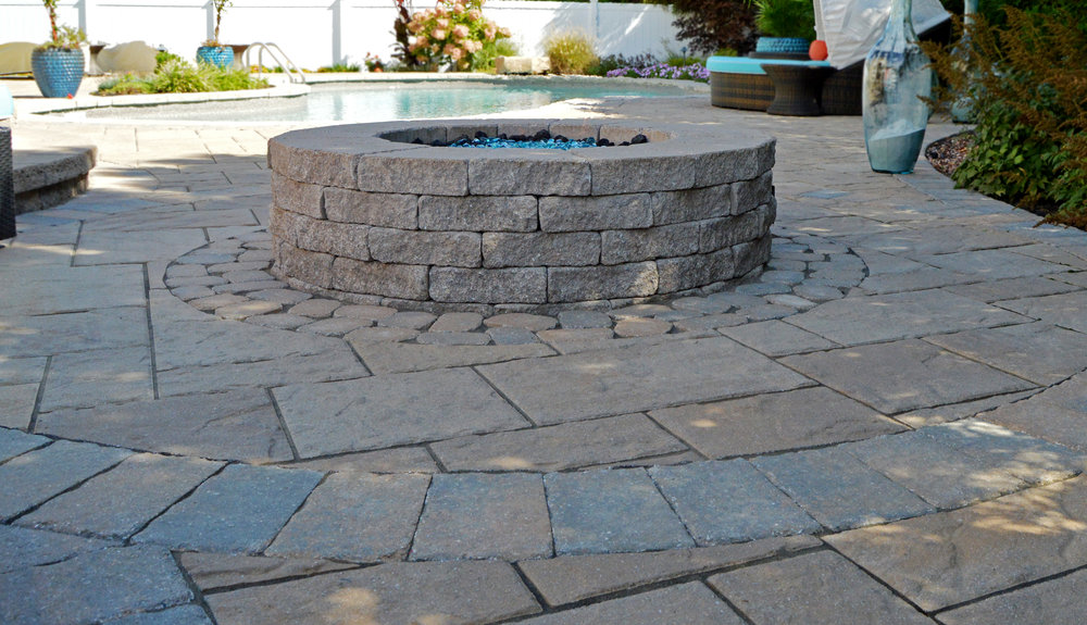 Bethpage, NY patio with a fire pit