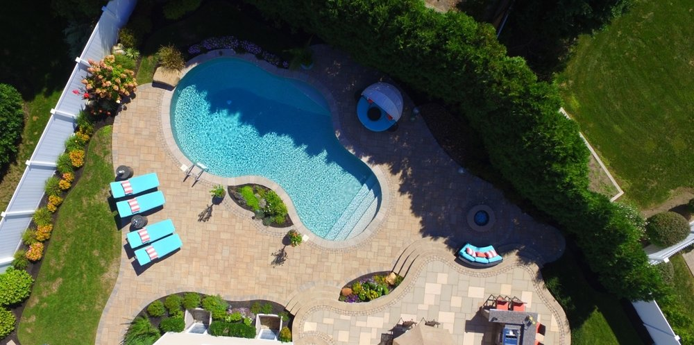 smithtown, NY shot of swimming pool, patio, and outdoor kitchen project