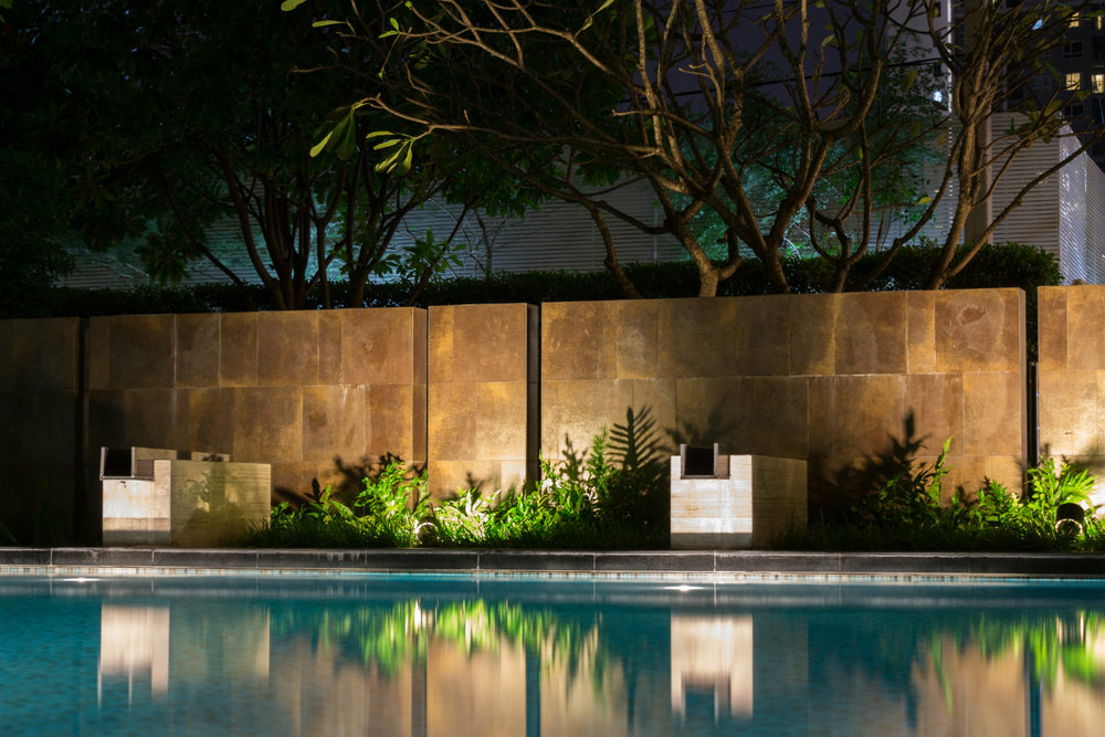 using landscape lighting to highlight trees and plants above all