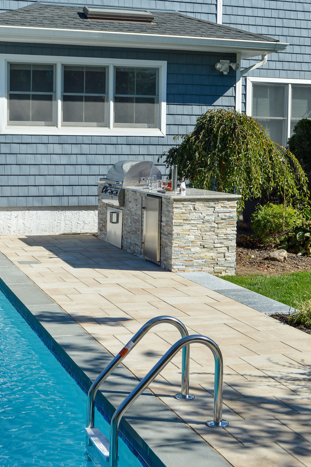 Landscape design with an outdoor kitchen in Plainview, NY