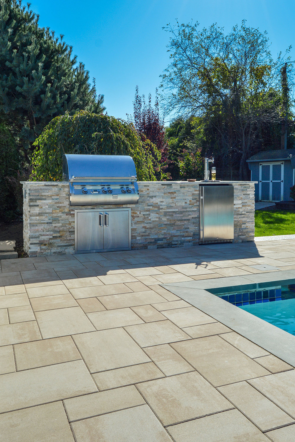 Patio with outdoor kitchen in Plainview, NY