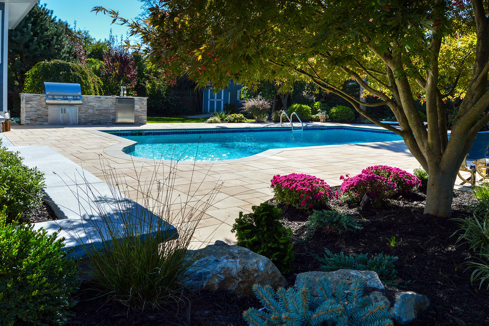 Smithtown, NY patio with a swimming pool