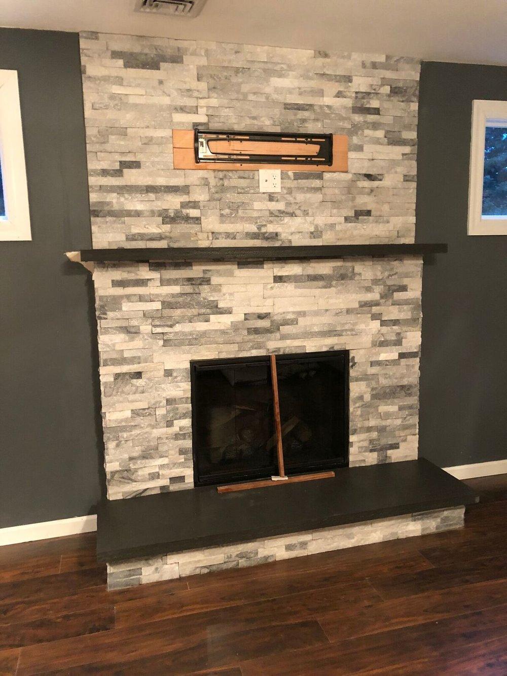 Grey and white interior masonry fireplace on Long Island NY