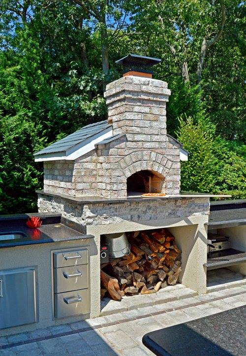Enjoy Outdoor Cooking by Incorporating a Pizza Oven into Your Outdoor Fireplace in Plainview, NY