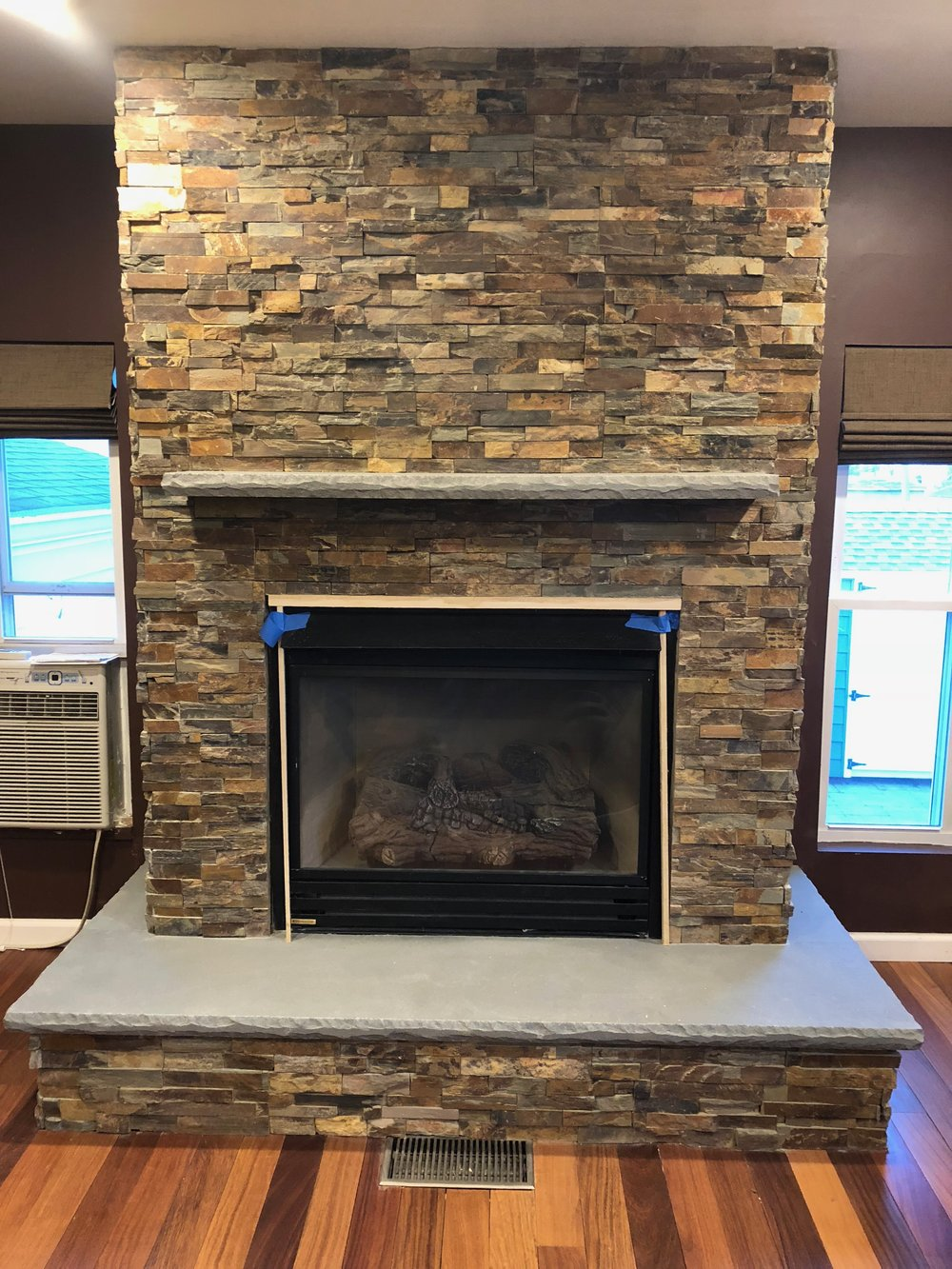 Decorate Your Living Room with Interior Brick and Stone Masonry Walls in Bethpage, NY
