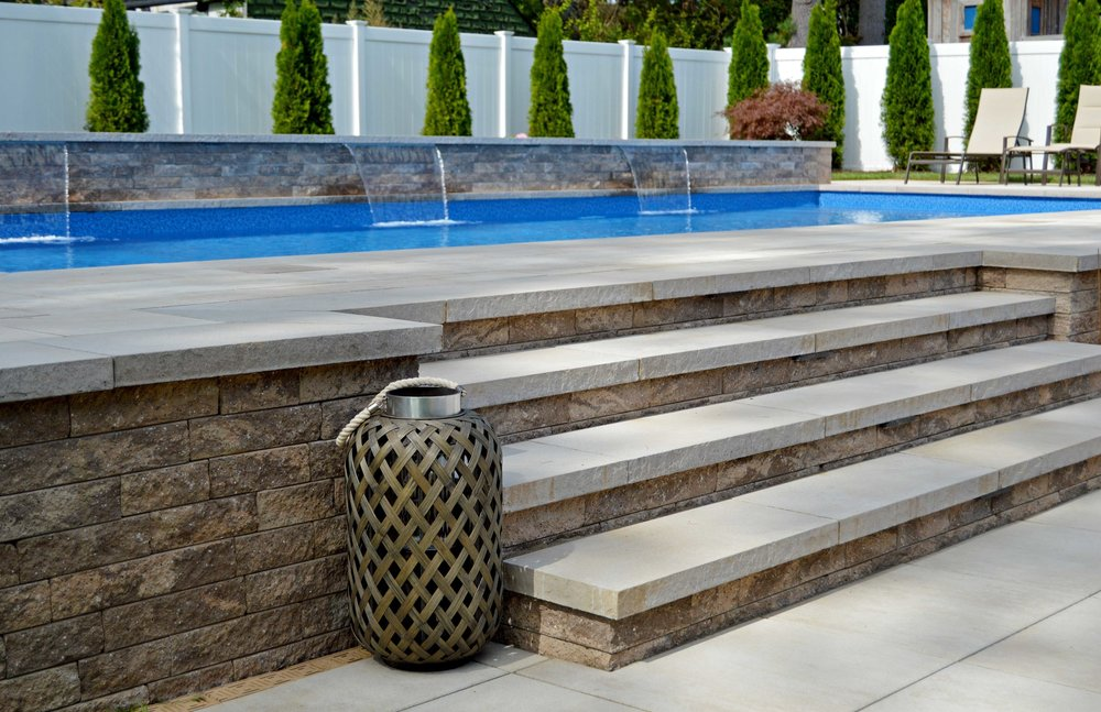 Stunning swimming pool landscape design in Hauppauge, NY
