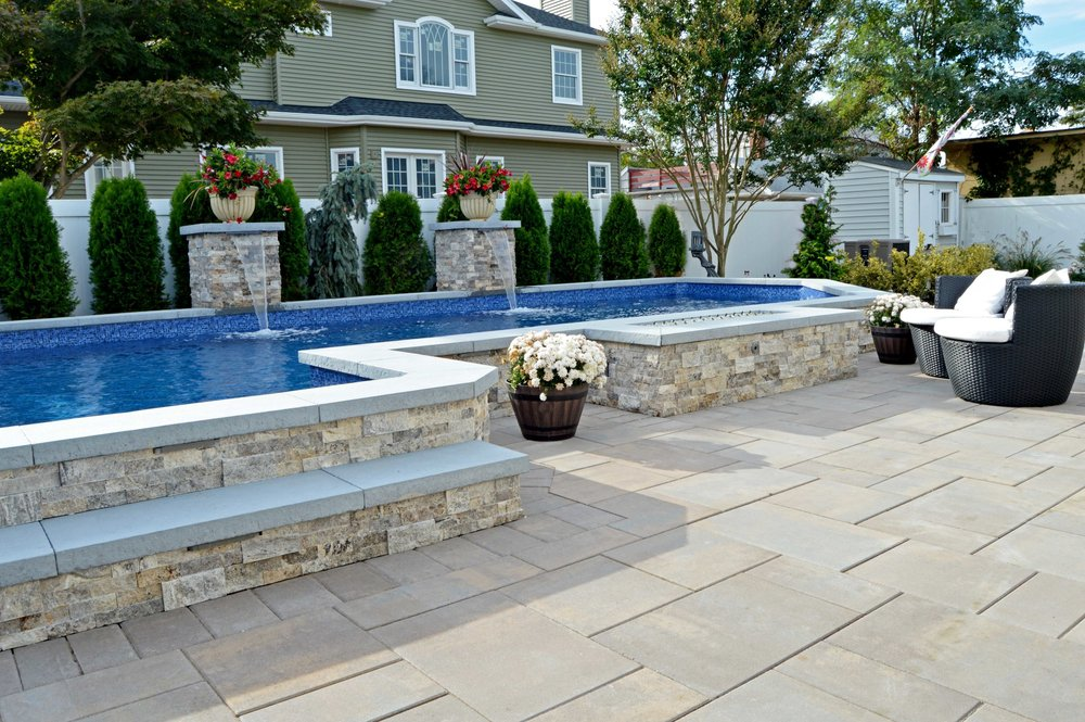 Landscape design in Melville NY, with swimming pool patio