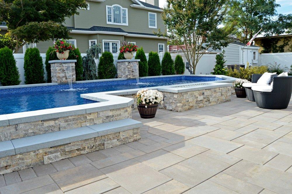 Swimming pool design with landscape lighting in Glen Cove, New York