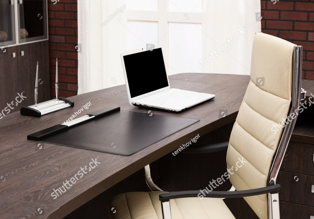 stock-photo-laptop-on-a-desk-in-a-modern-office-111215162.jpg