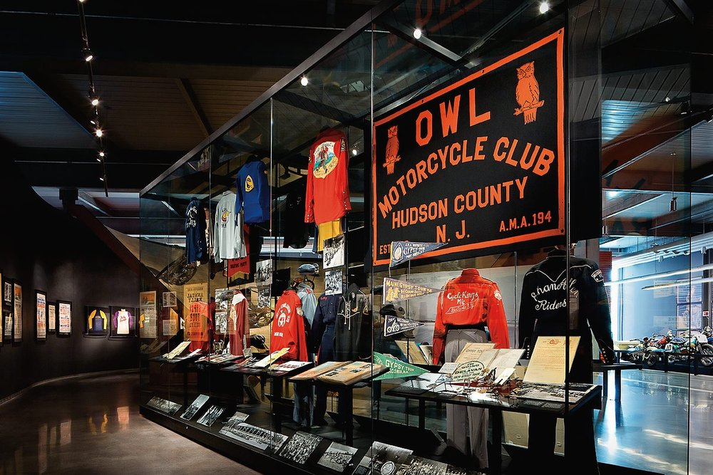 Harley Davidson Museum, Milwaukee, WI. Textiles cleaned, conserved, and mounted for exhibition. Photo courtesy of Harley Davidson Museum.