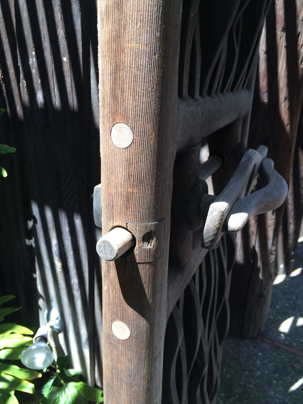 the ingenious latching mechanism. the gate is (I believe) redwood, and the pins are maple