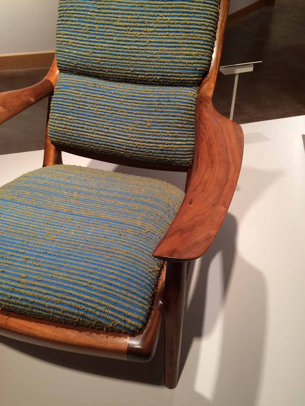 a more mature chair, with relatively unusual (for him) upholstery with a great fabric by Jack Lenor Larsen.