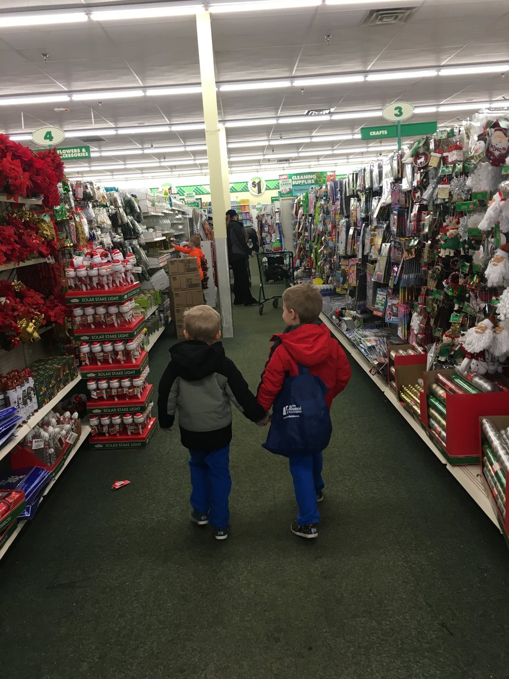we finally had the chance to do our annual trip to the dollar store for the boys to pick out christmas presents if you remember because everything is so