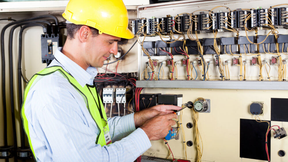 services-electrical-contracting-electrician-at-panel.jpg