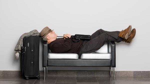 travel-sleeping-airport.jpg