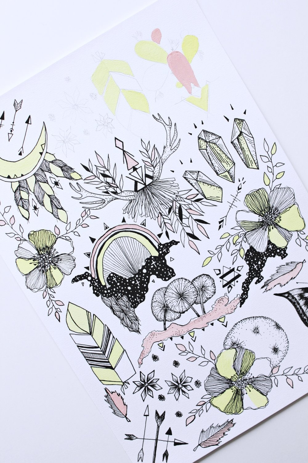 Drawing a colorful flash sheet with black pen and paints. Flowers, feathers and other symbolic details.