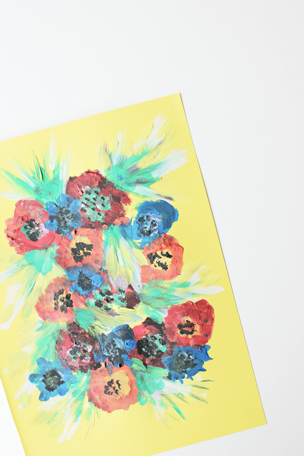Flowers painted with tempera on colored cardboard