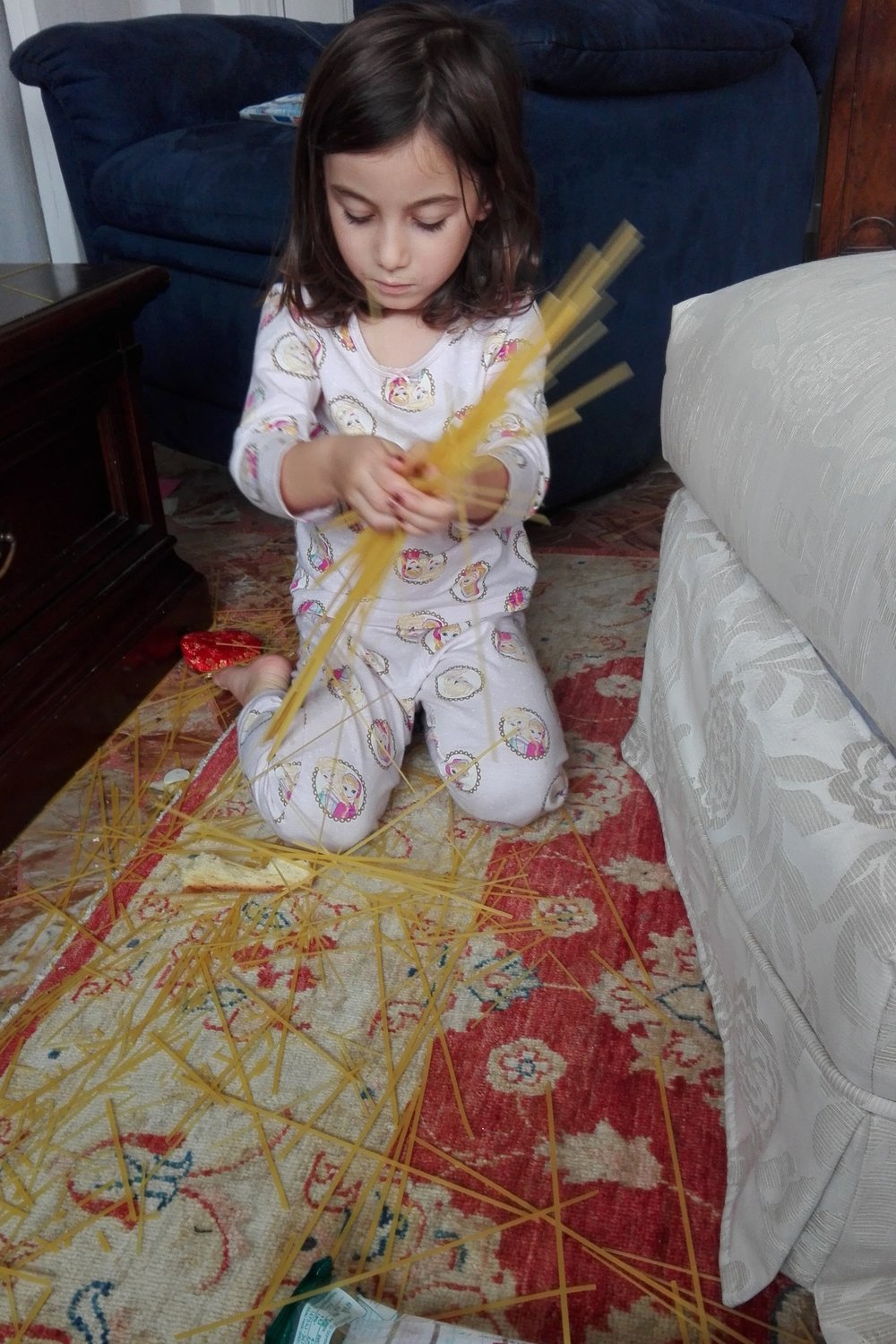 Yes this is spaghetti. Yes it's all over the floor. I'm not sure about the game but I'm sure about the learning.  She was very focused and had a purpose.  It's not true that four year olds have short attention spans.