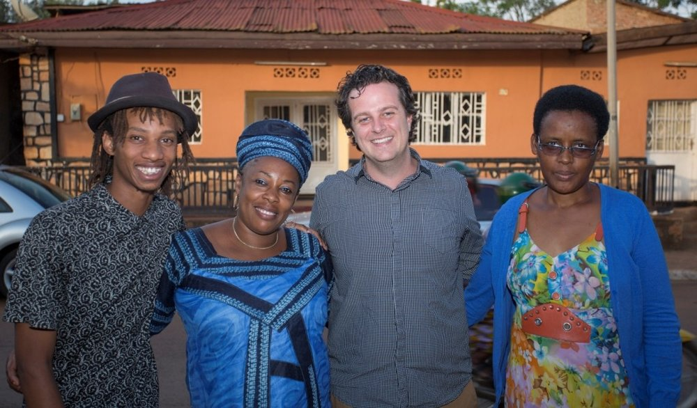 SCOTT WILHELM, SECOND FROM RIGHT, WITH THREE RWANDAN ENTREPRENEURS WHO OFFER THEIR SERVICES ON VAYANDO. PHOTO: VAYANDO.