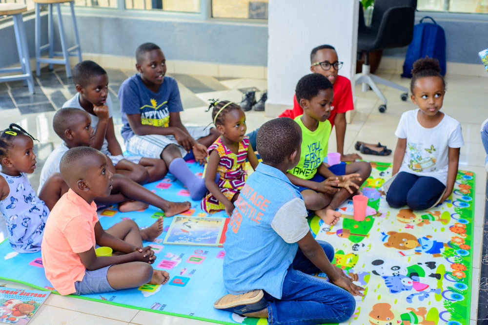 "- Story Hour with Dominique Alonga, founder of ImagineWe, who was reading her book, ""ABCs of Rwanda!"""
