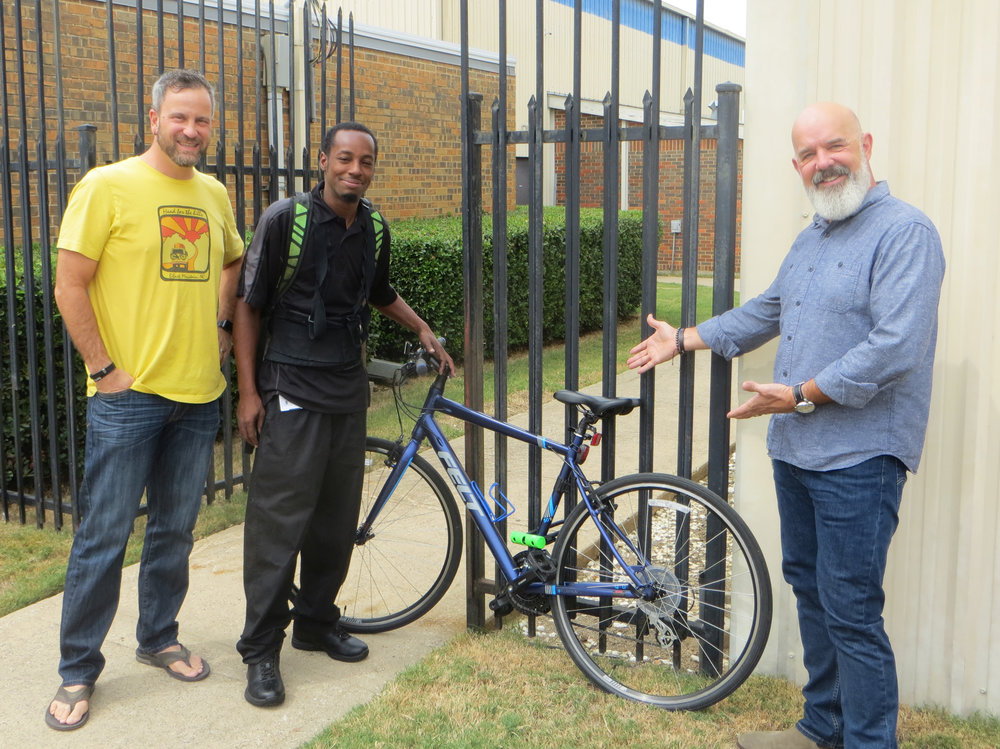 BridgeBuilders Resident Bike Experts Delton (left) and Michael with Dewayne (middle)