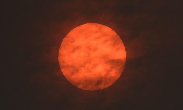 Red sun , Toby Melville:Reuters, taken near Exeter