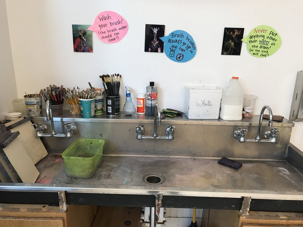 Our sink has signs that remind kids how to wash and store the brushes.