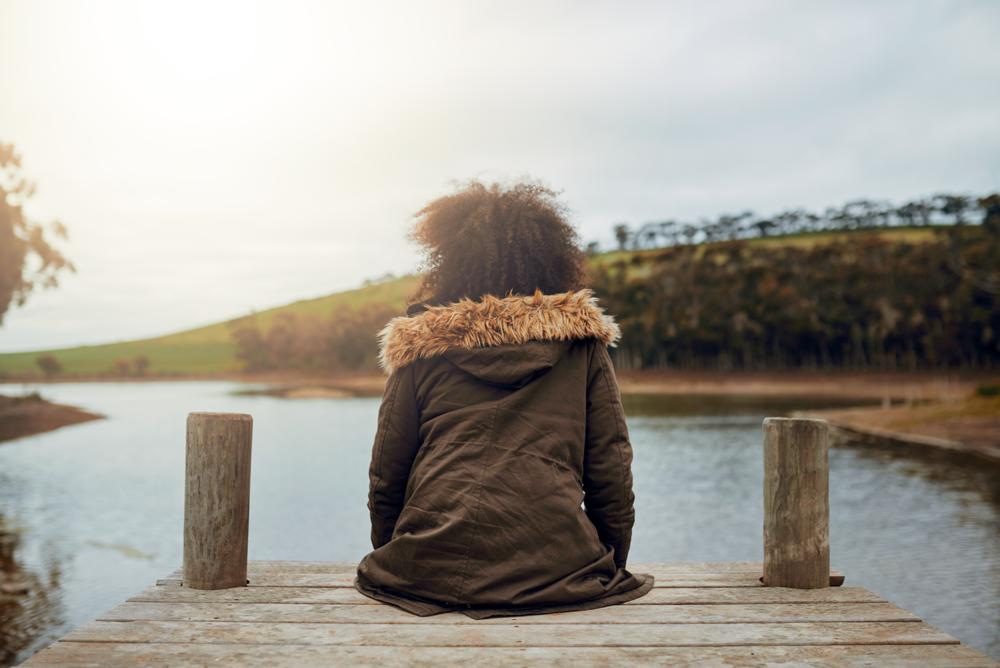 girl on dock meditating.png