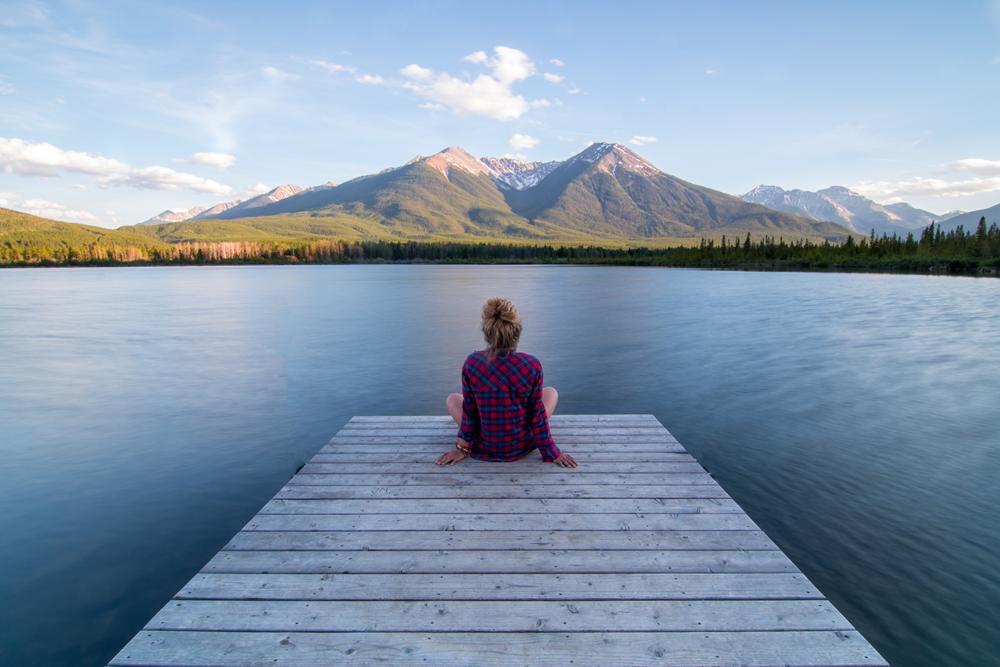 girl meditates on dock.png
